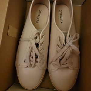 Soft pink sneakers.